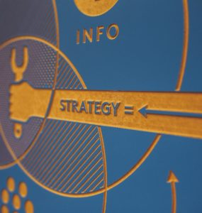 "Photo of a board containing the words ""info"" and ""strategy"""